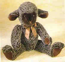 Li'l Trubbles is a mottled ebony floppy lamb 13 1/2 inchess tall