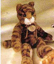 Tabatha is a tabby cat with a leather name tag 12 1/2 inches tall